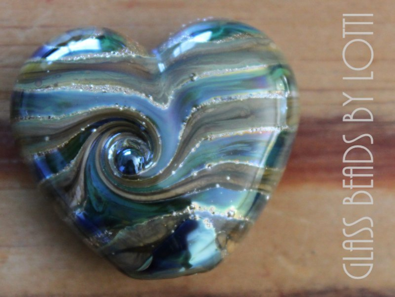Blue 'heart planet' bead